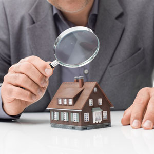 magnifying glass over model home commercial and residential property inspections